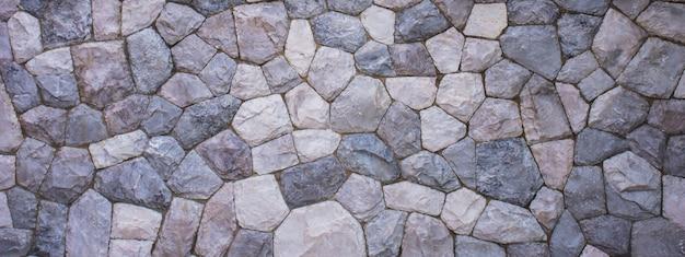 La texture du mur de pierre pour le fond Photo Premium