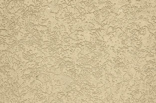 La texture du plâtre décoratif beige dans le style de dendroctone Photo Premium