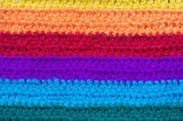 La texture du tissu est tricotée à partir de fils multicolores. Photo Premium