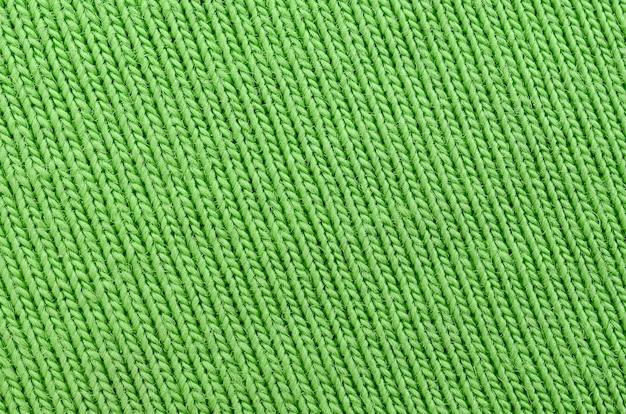La texture du tissu est vert vif. matériel pour la confection de chemises et de chemisiers Photo Premium