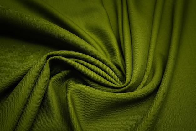 La texture du tissu en laine est vert foncé. Photo Premium