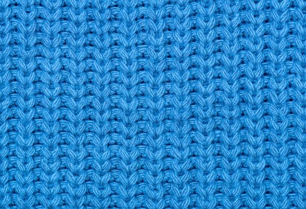La texture du tricot en bleu. Photo Premium