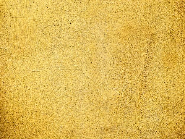 Texture Du Vieux Mur Plâtré Avec Des Fissures Peintes En Jaune. Fond Grunge Vide Photo Premium