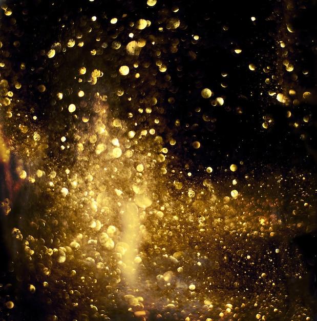 Texture d'éclairage bokeh de paillettes d'or abstrait flou Photo Premium