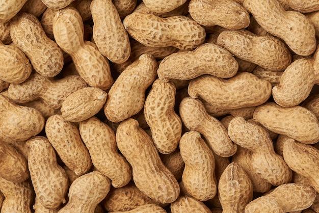 Texture de fond de cacahuètes Photo Premium