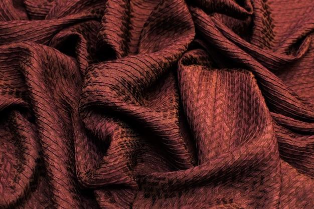 La Texture De Fond Du Tissu En Soie Est Brun Foncé Photo Premium