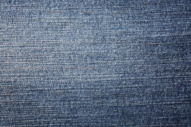 Texture et fond de jeans en denim bleu. Photo Premium