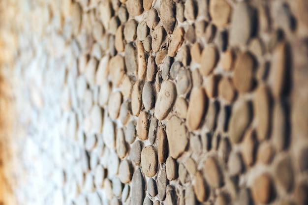 Texture de fond de mur de pierre rond différent Photo Premium