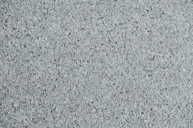 Texture de fond de mur et de plancher en béton de finition agrégée. Photo Premium