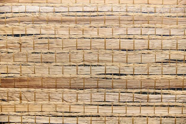 Texture de fond d'une serviette en bambou avec des cordes. Photo Premium
