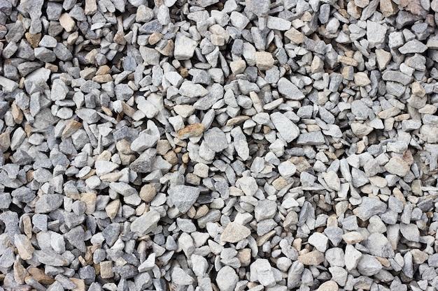 Texture de gros plan gros plan de pierre concassée. Photo Premium