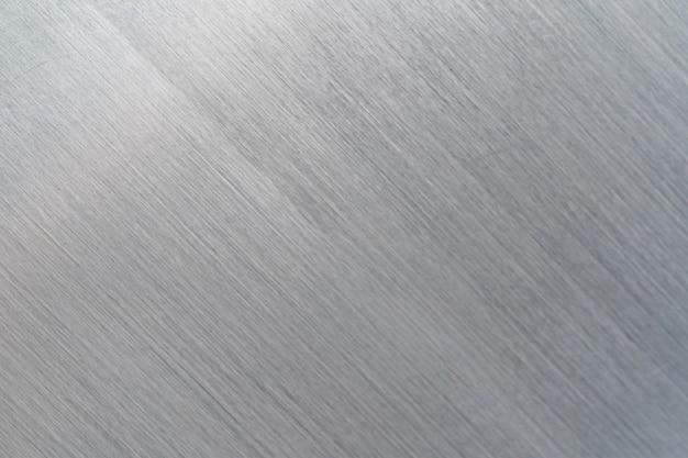Texture en métal rayé, fond de plaque en acier brossé Photo Premium
