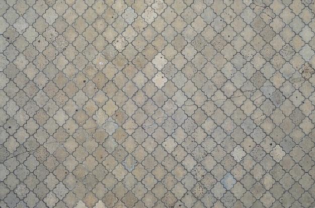 La texture d'une mosaïque rythmique faite de dalles en béton. Photo Premium