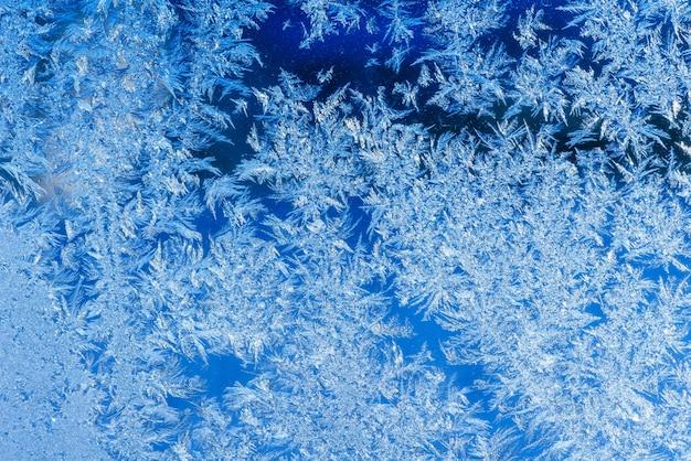 Texture des motifs sur fenêtre gelée Photo Premium