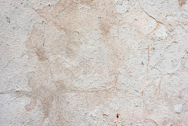 Texture d'un mur de béton avec des fissures et des rayures Photo Premium
