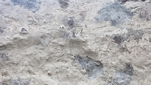 Texture de mur de briques peintes et fissurées gris Photo gratuit