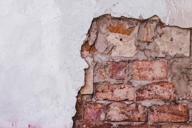 Texture de mur de briques vintage grunge et stuc blanc fond de façade de bâtiment Photo Premium