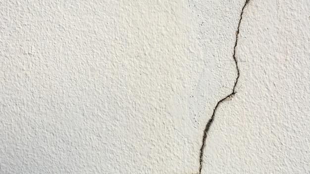 Texture de mur de ciment blanc fissure - fond Photo Premium