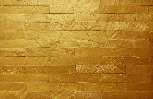 Texture de mur en pierre d'ardoise d'or en motif naturel avec une haute résolution pour le fond Photo Premium