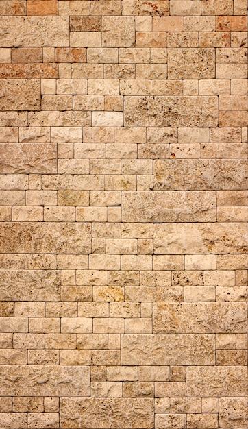 Texture De Mur En Pierre, Carreau De Travertin Jaune Carré. élément De Conception Ou Arrière-plan. Photo Premium