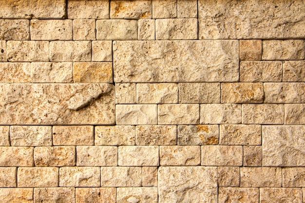 Texture De Mur En Pierre, Carreau De Travertin Jaune Carré. Photo Premium