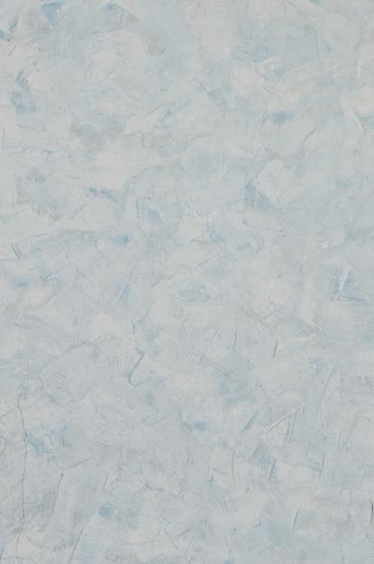 Texture de mur de plâtre bleu vieux patiné et teinté Photo Premium