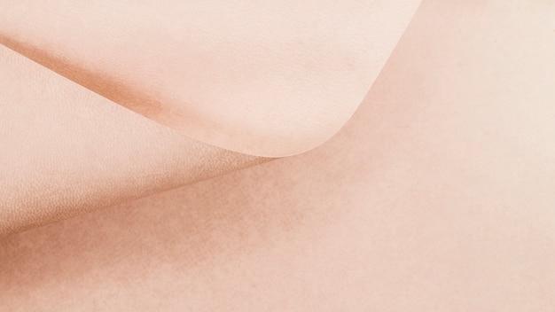 Texture de page rose recourbé Photo gratuit