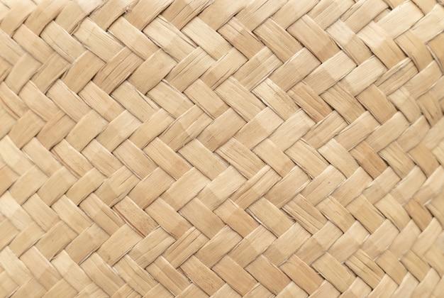 Texture de panier en bambou à utiliser comme arrière-plan. modèle de panier tissé et texture. Photo Premium