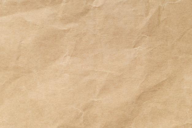 Texture de papier froissé brun pour le fond. Photo Premium