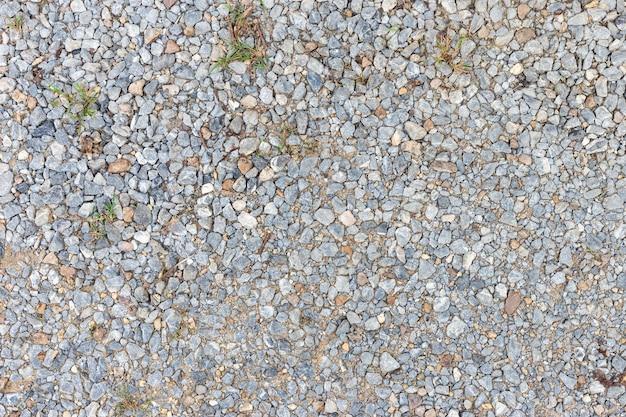 Texture de sable ou de galets colorée. texture transparente sur le sol. Photo Premium