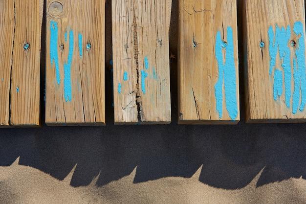 Texture de sable de plage avec des rayures en bois vieilli Photo Premium