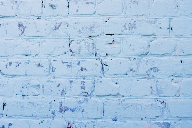 Texture de la surface du mur de brique bleu ancien avec des joints de ciment Photo Premium
