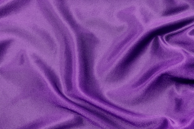 Texture de tissu violet pour le fond et le design, belle soie ou lin. Photo Premium
