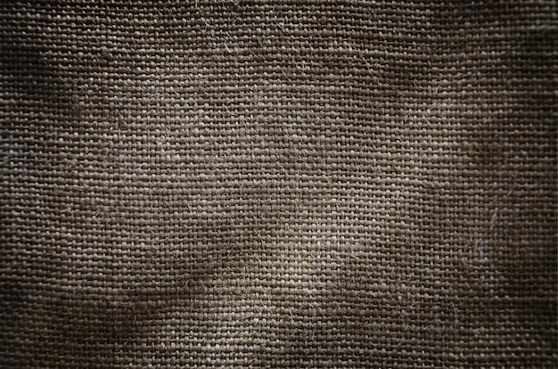 La texture d'un très vieux tissu de sac brun Photo Premium