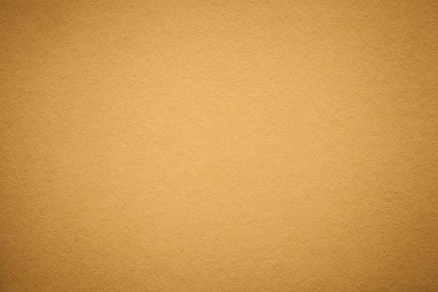 Texture de vieux fond de papier doré Photo Premium