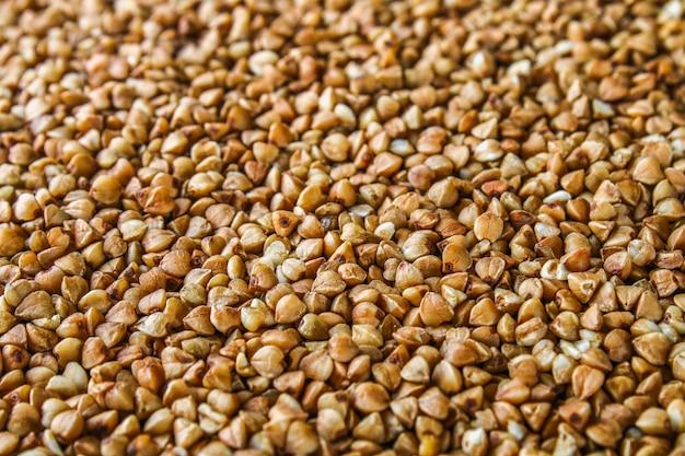 Textures de grains de sarrasin crus. la nourriture saine. vue de dessus Photo Premium