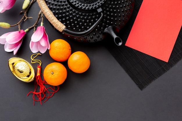 Théière Avec Carte Maquette Du Nouvel An Chinois Photo gratuit