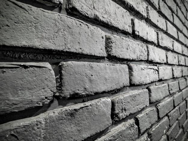 Tir En Niveaux De Gris D'un Beau Mur De Briques - Parfait Pour Un Arrière-plan Cool Photo gratuit