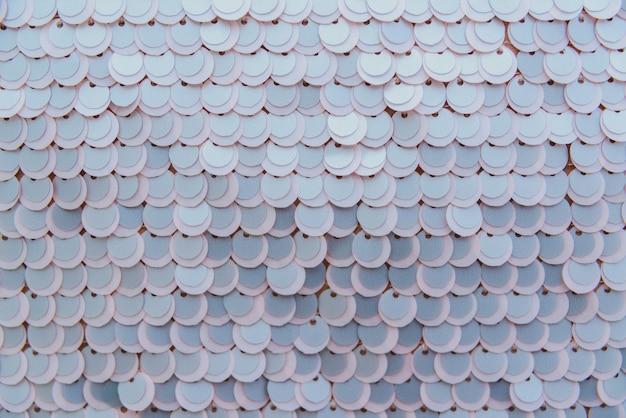 Tissu beige brillant avec des paillettes, abstrait. Photo Premium