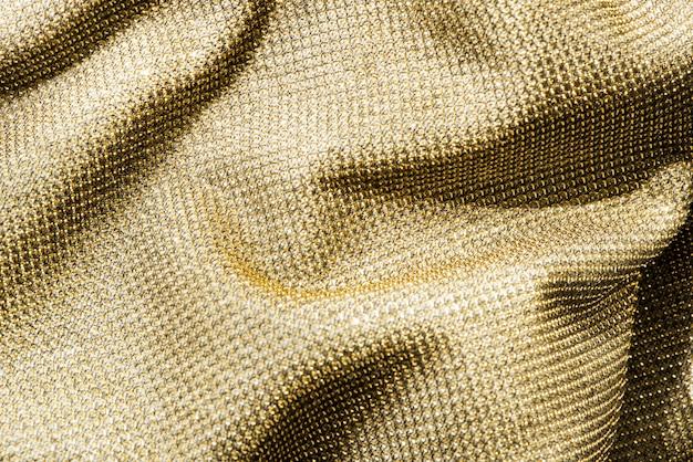 Tissu d'or froissé Photo gratuit