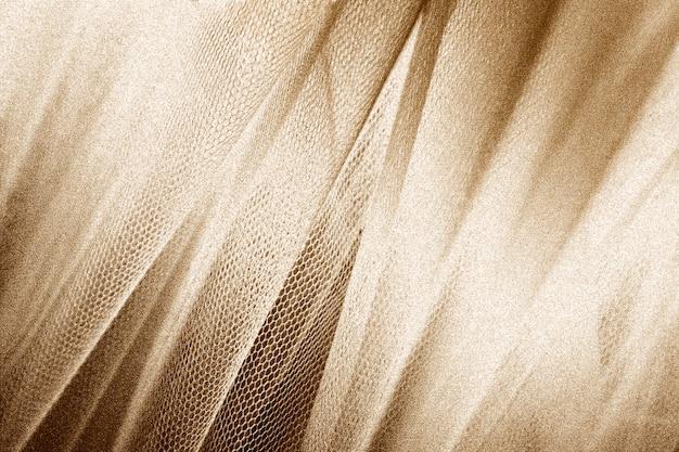 Tissu Or Soyeux Peau De Serpent Texturé Photo gratuit
