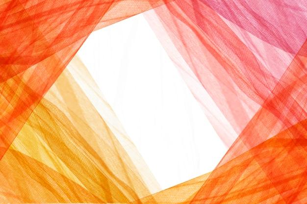 Tissus aux couleurs chaudes formant un cadre Photo Premium