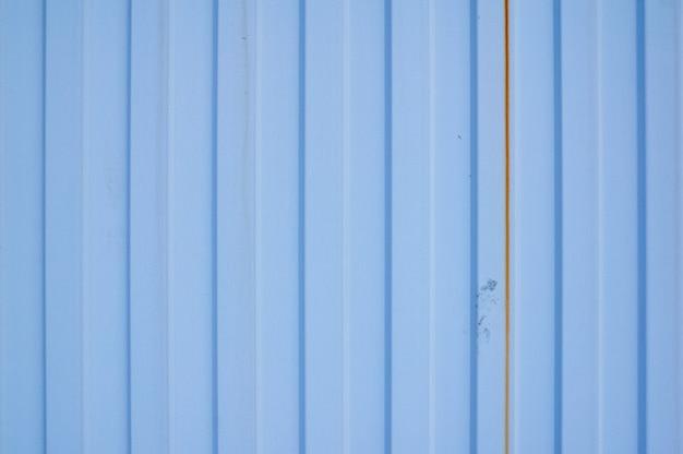 Tôle en métal bleu à rayures verticales Photo Premium