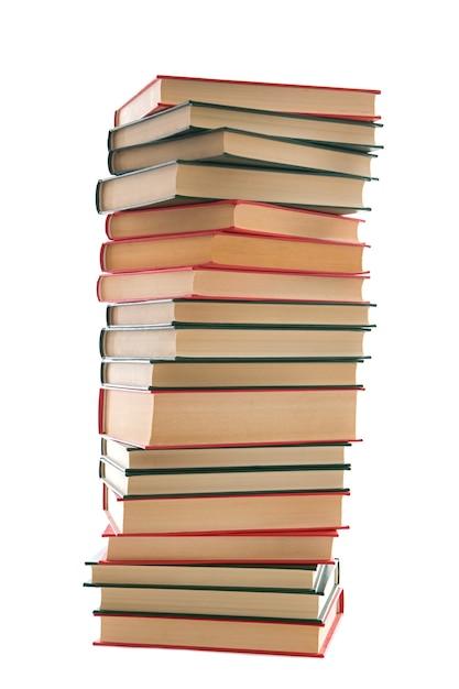 Tour de livres sur fond blanc Photo Premium