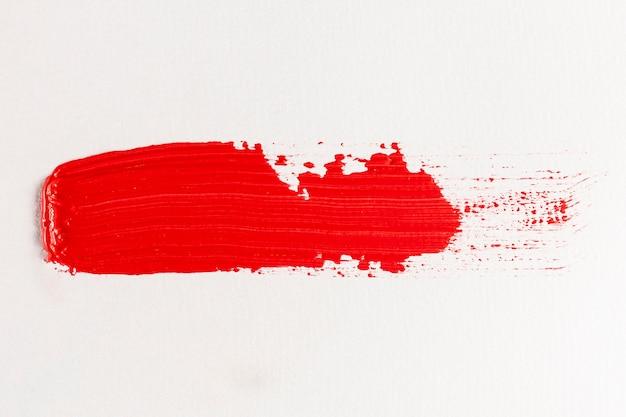 Traînée de peinture rouge simple barbouillé Photo gratuit