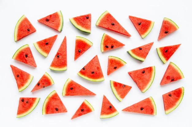 Tranches de melon d'eau isolé sur blanc. Photo Premium