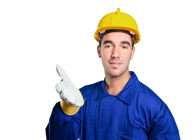 Travailleur confiant avec un geste de poignée de main sur fond blanc Photo Premium