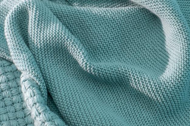 Tricoté à la main avec une belle texture en laine Photo Premium