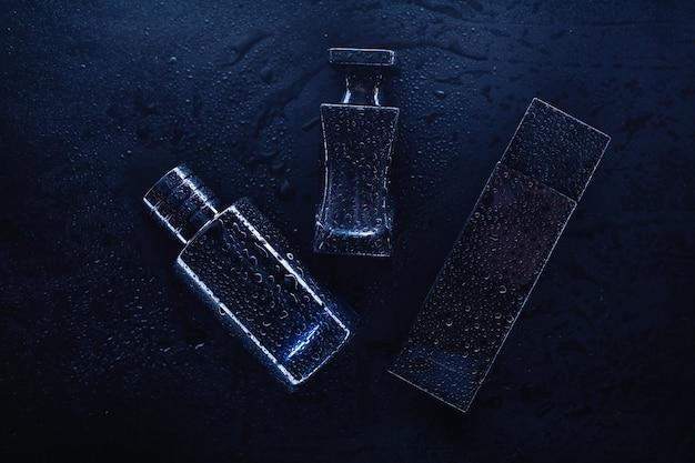 Trois Parfums Différents Sur Fond Sombre Photo Premium