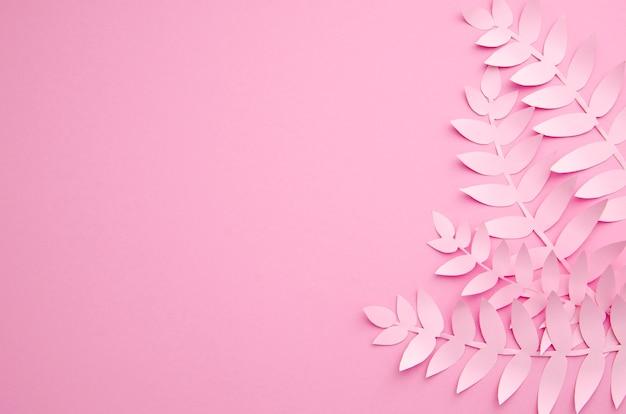 Usines de papier exotiques origami sur fond rose Photo gratuit